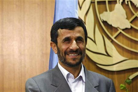 Iranian President Mahmoud Ahmadinejad smiles as he meets with United Nations Secretary-General Ban Ki-moon at the United Nations in New York September 24, 2007. REUTERS/Eric Thayer