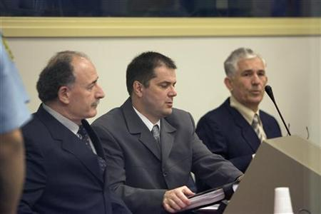 Mile Mrksic (R), Miroslav Radic (L) and Veselin Sljivancanin attend the UN's War Crimes Tribunal in The Hague October 10, 2005. Judges at the U.N. war crimes tribunal will rule on Thursday whether three former Yugoslav officers were criminally responsible for the 1991 massacre of non-Serbs in the Croatian town of Vukovar, one of the most brutal episodes of the Balkans wars. REUTERS/Rob Keeris/Pool