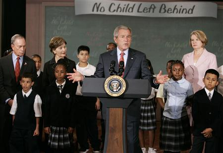 President George W. Bush talks, surrounded by children from Public School 76, in New York, September 26, 2007. Offering a grammar lesson guaranteed to make any English teacher cringe, Bush told the group of school kids on Wednesday: ''Childrens do learn.'' REUTERS/Larry Downing