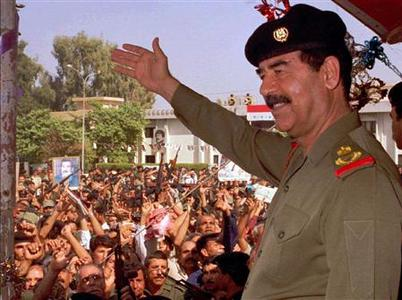 Saddam Hussein in a 1998 photo. Hussein was prepared to take $1 billion and go into exile before the Iraq war, according to a transcript of talks between President Bush and an ally, Spanish newspaper El Pais reported on Wednesday. REUTERS/File