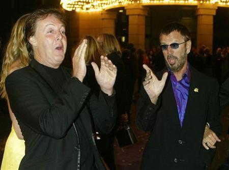 Paul McCartney (L) and Ringo Starr share a light moment together as they arrive for a screening of ''Concert for George'', at Warner Bros. studios in Burbank, California September 24, 2003. REUTERS/Fred Prouser FSP