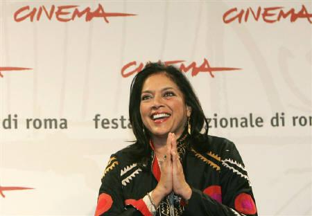 Director Mira Nair poses during a photocall at Rome's first international film festival in this October 16, 2006 file photo. Nair will next year start filming ''Shantaram'', a film based on the bestselling novel by an escaped convict and that stars Johnny Depp and Amitabh Bachchan, an Indian newspaper reported on Friday. REUTERS/Dario Pignatelli