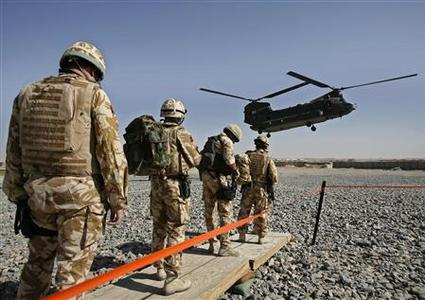 British soldiers from the NATO force embark on a helicopters in Afghanistan's southern Helmand province, September 27, 2007. REUTERS/Omar Sobhani