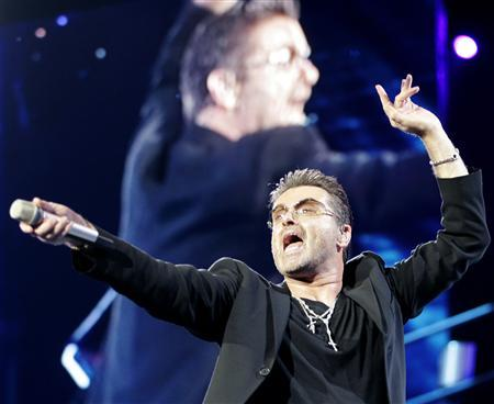 George Michael performs in Athens, July 26, 2007. Michael is trying to reduce his consumption of marijuana, the pop star told the BBC on Sunday. ''I'm constantly trying to smoke less marijuana. I'd like to take less and to a degree it's a problem,'' Michael told BBC Radio 4's Desert Island Discs program. REUTERS/John Kolesidis