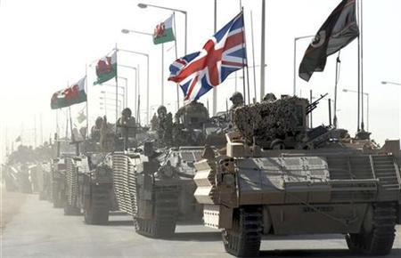 A convoy of British armoured vehicles patrol a road after pulling out from Basra Palace, in Basra, 550 km (342 miles) south of Baghdad September 3, 2007. Residents of Iraq's southern city of Basra have begun strolling riverfront streets again after four years of fear, their city much quieter since British troops withdrew from the grand Saddam Hussein-era Basra Palace. REUTERS/Handout