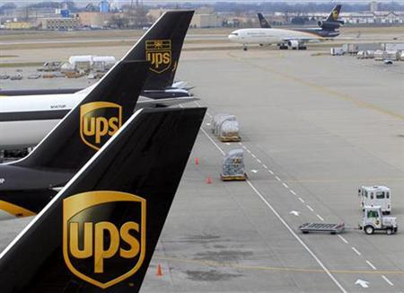United Parcel Service aircraft are loaded with containers at the UPS Worldport All Points International Hub in Louisville, in a 2006 photo. The Teamsters union and UPS on Sunday said they reached a tentative five-year agreement that will raise parcel workers' wages and increase the company's contributions to funds providing pensions and benefits. REUTERS/John Sommers II