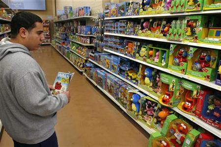 A customer shops at a Wal-Mart in Chicago in a file photo. Christmas started in September this year -- at least in the toy aisles at Wal-Mart Stores Inc -- even as retailers worry that parents may approach toy shopping with trepidation this holiday season after massive numbers of toys were recalled in recent months. REUTERS/Joshua Lott