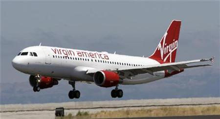 The first Virgin America flight lands in San Francisco, California, August 8, 2007. The launch of low-cost airline Virgin America Inc this year has triggered a fare war that has nearly halved ticket prices on some routes and could erode earnings at rival airlines. REUTERS/John Decker Virgin America/Pool