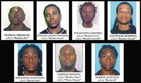 A combination of handout photographs provided by the U.S. Department of Justice shows the seven people arrested in Miami Thursday, who U.S. officials said on June 23, 2006, had discussed attacks on the landmark Sears Tower in Chicago, the FBI building in Miami and other government buildings. Seven men plotted to bring down the U.S. government by poisoning saltshakers and bombing landmark buildings, a prosecutor told Miami jurors as their terrorism conspiracy trial opened on Tuesday. REUTERS/Department of Justice/Handout