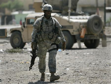 A U.S. soldier of Bravo company, 2nd Battalion, 17th Field Artillery Regiment walks during a patrol in the Zafraniya neighborhood in the southeast of Baghdad, September 20, 2007. REUTERS/Carlos Barria