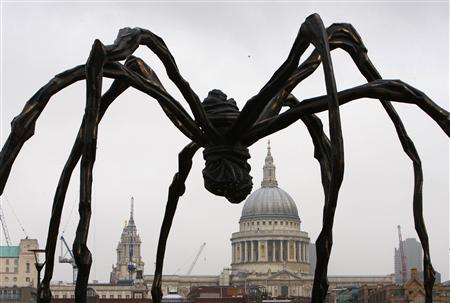 A sculpture of a spider by French born artist Louise Bourgeois is seen outside Tate Modern, central London October 3, 2007. The sculpture was installed outside the Tate as part of a major exhibiton of work by Bourgeois. REUTERS/Kieran Doherty