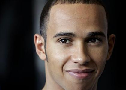 McLaren's Formula One driver Lewis Hamilton of Britain smiles before a practice session for the Chinese F1 Grand Prix in Shanghai October 5, 2007. REUTERS/Aly Song