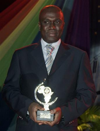 Legal adviser Narcisse Aka holds his trophy at ''Punctuality Night'' in Abidjan October 6, 2007. REUTERS/Thierry Gouegnon
