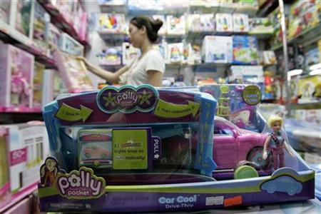 A customer looks at toys at a store in Shanghai August 15, 2007. The recent flurry of toy recalls because of lead-paint contamination and other safety issues will ultimately cost worried parents more than just lost peace of mind. REUTERS/Aly Song