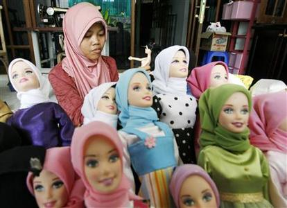 A worker is surrounded by Salma dolls as she dresses one in Jakarta September 25, 2007. REUTERS/Supri