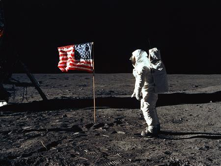 Astronaut Buzz Aldrin is seen with the American flag on the surface of the moon during the Apollo 11 moon landing mission in a historical photo from NASA. The gap between perceptions of the United States as a can-do-everything country, a country that can put a man on the moon, and the reality of a place where things can go wrong, and often do, never closed. REUTERS/NASA/Handout