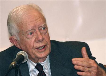Former President Jimmy Carter speaks during a news conference in Kathmandu, Nepal, June 16, 2007. Carter on Wednesday denounced Vice President Dick Cheney as a ''disaster'' for the country and a ''militant'' who has had an excessive influence in setting foreign policy. REUTERS/Shruti Shrestha