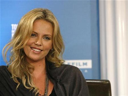 Charlize Theron smiles during a news conference for the movie ''Battle in Seattle'' during the 32nd Toronto International Film Festival September 9, 2007. REUTERS/Mario Anzuoni