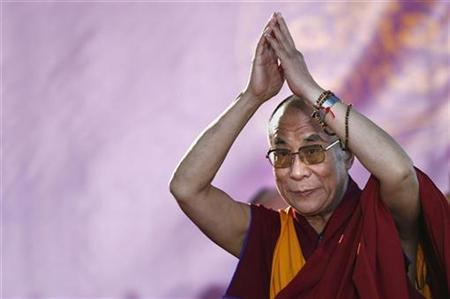 Tibet's spiritual leader the Dalai Lama salutes the crowd after his speech at the open-air museum Hessenpark in Neu-Anspach some 30 kilometres north of Frankfurt September 22, 2007. China has complained to the United States over a decision to award exiled Tibetan spiritual leader the Dalai Lama a U.S. Congressional Gold Medal, a Chinese Foreign Ministry spokesman said on Thursday. REUTERS/Alex Grimm