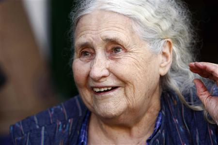 British novelist Doris Lessing smiles on the doorstep of her house in London October 11, 2007. REUTERS/Kieran Doherty