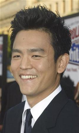 John Cho poses at a film's premiere in Hollywood July 27, 2004. REUTERS/Fred Prouser