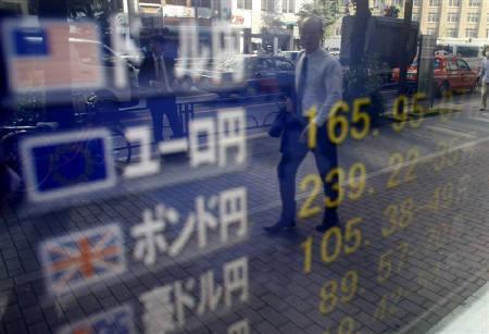 10月12日、来週の外為市場では米株価上昇の一服感が予想されドルは売り優勢の展開になりそうだ。11日撮影(2007年 ロイター/Kim Kyung-Hoon)