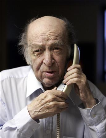 Leonid Hurwicz speaks on the phone in his apartment after he received news that he had won the Nobel Prize in Economic Sciences in Minneapolis October 15, 2007. REUTERS/Eric Miller