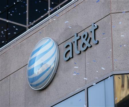 The AT&T logo in an undated handout photo. AT&T Inc, the biggest U.S. mobile service, said on Tuesday that it will reduce some fees for customers who exit phone contracts before they are completed, in an effort to offer users more flexibility. REUTERS/Handout