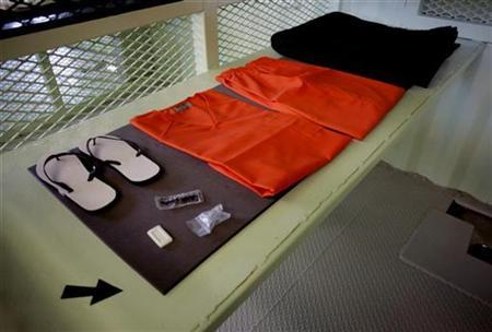 Items given to detainees at Camp Delta are shown in a cell at the Guantanamo Bay Naval Station in Guantanamo Bay, Cuba September 4, 2007. The U.S. military has ended an inquiry into who smuggled unauthorized underwear and a bathing suit to two prisoners at Guantanamo Bay without learning the source of the contraband skivvies, an attorney said on Wednesday. REUTERS/Joe Skipper