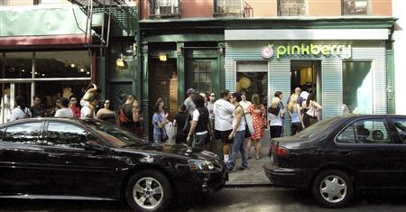 Customers line up outside a Pinkberry frozen yogurt store on Spring Street in New York in this undated publicity handout released to Reuters October 17, 2007. It's fat free, has a celebrity following and its own tune, and it's likely to be coming to a city near you very soon. It's a tart but sweet frozen yogurt called Pinkberry and it has taken Los Angeles by storm since the first store opened two years ago in hip West Hollywood serving up pricey portions with customized toppings. REUTERS/Pinkberry/Handout
