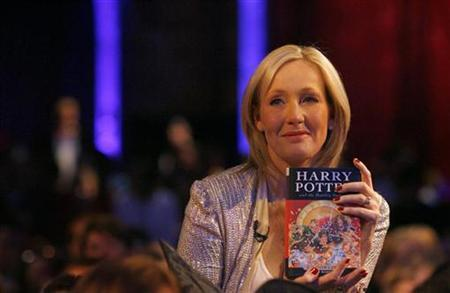 J.K. Rowling poses with a copy of her new book ''Harry Potter and the Deathly Hallows'' at the Natural History Museum in London July 20, 2007. Rowling has outed one of the main characters of her best-selling Harry Potter series, telling fans in New York that the wizard Albus Dumbledore, head of Hogwarts school, is gay. REUTERS/Alessia Pierdomenico