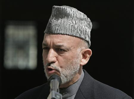 Afghanistan's President Hamid Karzai condemns the bomb attack in Karachi, during a news conference in Kabul, October 19, 2007. Afghanistan and its neighbors must launch a regional campaign against terrorism in order to make the most of their natural resources and develop trade, Karzai said on Saturday. REUTERS/Omar Sobhani