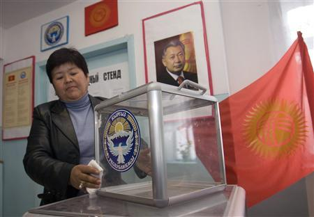 A member of the local election committee sets up a ballot box in a village of Baytik outside Bishkek October 20, 2007. Kyrgyzstan voted on Sunday in a constitutional referendum designed to ease tensions in the Central Asian state but criticised by the opposition as a step towards authoritarianism. REUTERS/Vladimir Pirogov