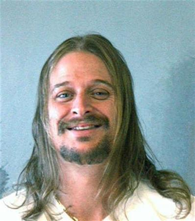 A handout photo shows a police mug shot of musician Kid Rock, whose real name is Robert James Ritchie, after he was arrested early Sunday morning following an altercation at a Waffle House in Dekalb County, Georgia October 21, 2007. Ritchie who was in town for a show was released hours later after posting bond. REUTERS/Dekalb Sheriff's Office