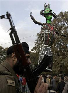 A policeman stands guard next to an effigy of Ravana during Dussehra celebrations in Srinagar, October 21, 2007. Hundreds of chanting Hindus burnt a huge effigy of the demon king to mark one of their biggest festivals for the first time in Kashmir since Muslim militants launched a revolt 18 years ago. REUTERS/Danish Ismail
