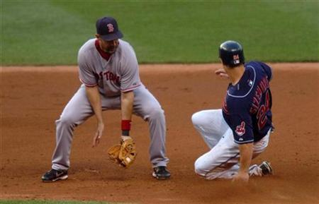 Cleveland Indians Grady Sizemore slides into second with a stolen base as Boston Red Sox short stop Julio Lugo takes throw from catcher Jason Varitek in Cleveland, Ohio July 24, 2007. Taco Bell on Monday unveiled a promotion it is calling ''Steal a Base, Steal a Taco,'' which will run through the World Series. REUTERS/Ron Kuntz