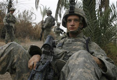 A U.S. soldier with Alpha Company, 1st Battalion, 30th Infantry Regiment, takes a break after finding a weapons cache during a search mission in the Sunni neighbourhood of Arab Jabour in south Baghdad October 19, 2007. Violence in Iraq has dropped by 70 percent since the end of June, the Interior Ministry said on Monday. REUTERS/Fabrizio Bensch