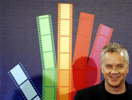 Tim Robbins smiles during a photocall to promote the film ''Catch A Fire,'' in Madrid January 15, 2007. ''Noise'', director Henry Bean's provocative second film, casts Tim Robbins as David, an upper-class family man driven insane by New York's loud sounds. REUTERS/Sergio Perez