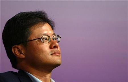 Yahoo Chief Executive Jerry Yang attends the ''Chinese Americans in the World'' Leadership Forum at Tsinghua University in Beijing September 23, 2005. Yang told advertising executives on Tuesday that Yahoo can differentiate itself by acting as an ''open'' alternative to rivals such as Google Inc. REUTERS/Alfred Cheng Jin