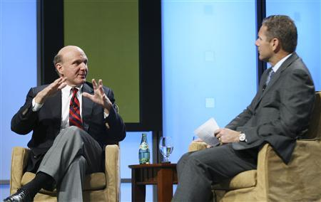 Microsoft CEO Steve Ballmer (L) answers a question from CTIA President and CEO Steve Largent after his keynote address at the Cellular Technology Industry Association (CTIA) conference in San Francisco, October 23, 2007. REUTERS/Lou Dematteis/Handout