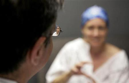File photo shows Dr. Maurice Nahabedian (L), who reconstructed cancer patient Deborah Charles' breast after a mastectomy, discussing upcoming operations with her during an appointment at Georgetown university Hospital in Washington, May 29, 2007. REUTERS/Jim Bourg