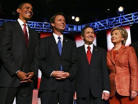 Democratic presidential candidates (L-R) Senator Barack Obama (D-IL), former Senator John Edwards (D-NC), Representative Dennis Kucinich, (D-OH), and Senator Hillary Clinton (D-NY) pose for photographers before their debate at Dartmouth College in Hanover, New Hampshire September 26, 2007. REUTERS/Lisa Hornak