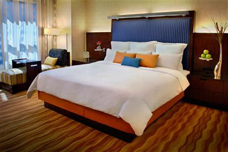 A bed is seen in a hotel room in an undated file photo. A few nights without sleep can not only make people tired and emotional, but may actually put the brain into a primitive ''fight or flight'' state, researchers said on Wednesday. REUTERS/PRNewsFoto/Marriott International, Inc.
