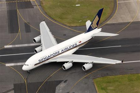An aerial view shows the Airbus A380 superjumbo as it taxis on the tarmac after landing at Sydney international airport, October 25, 2007. REUTERS/Singapore Airlines/James Morgan/Handout