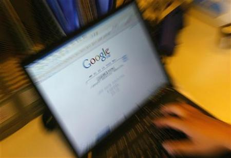 A laptop screen shows the homepage of Google.cn. in Beijing June 8, 2006. Google says it's grappling with an unusual challenge in China's Internet market -- how to cater to masses of Web surfers who go online for the first time via mobile devices, rather than migrating from PCs. REUTERS/Jason Lee