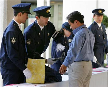 Security at Osaka International Airport in a file photo. Japan is to fingerprint and photograph foreigners entering the country from next month in an anti-terrorism policy that is stirring anger among foreign residents and human rights activists. REUTERS/Yuriko Nakao
