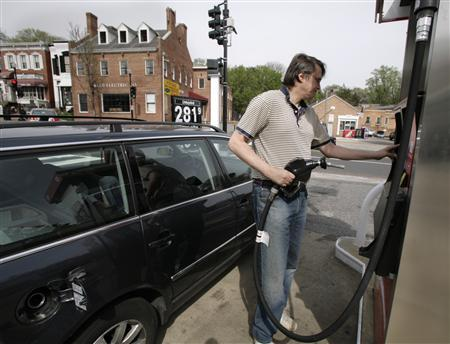 A driver fills his car at a small gas station in downtown Washington in a file photo. Oil rallied to a fresh record high above $92 a barrel on Friday as the dollar tumbled to a record low, Washington imposed new sanctions on Iran and gunmen shut more oil production in Nigeria. REUTERS/Yuri Gripas