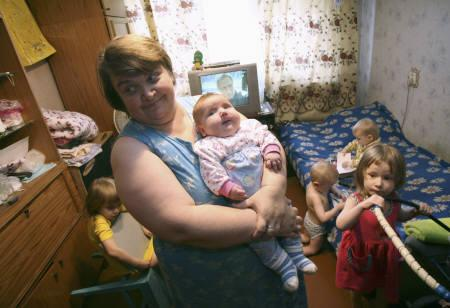 Tatyana Khalina holds baby Nadia, possibly the world's fattest baby, as her other children play at their apartment in the Siberian city of Aleisk October 26, 2007. REUTERS/Andrei Kasprishin