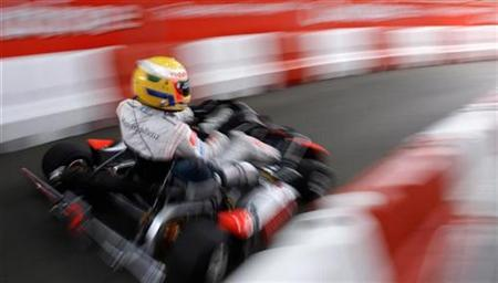 A Formula One racing driver drives his go-kart in central London June 21, 2007. A teen-ager speeding through a German town in a go-kart with seven squad cars in hot pursuit managed to give the frustrated officers the slip, police said on Friday. REUTERS/Kieran Doherty