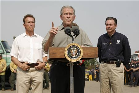 U.S. President George W. Bush speaks after touring wildfire affected areas around San Diego, California October 25, 2007. The U.S. government's main disaster-response agency apologized on Friday for having its employees pose as reporters in a hastily called news conference on California's wildfires that no news organizations attended. REUTERS/Kevin Lamarque
